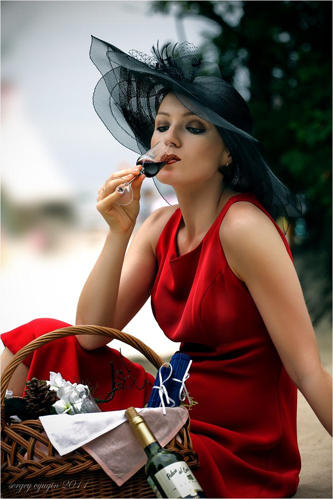 Girl drinking wine   wine, red dress, cartweel hat, enviromental portrait