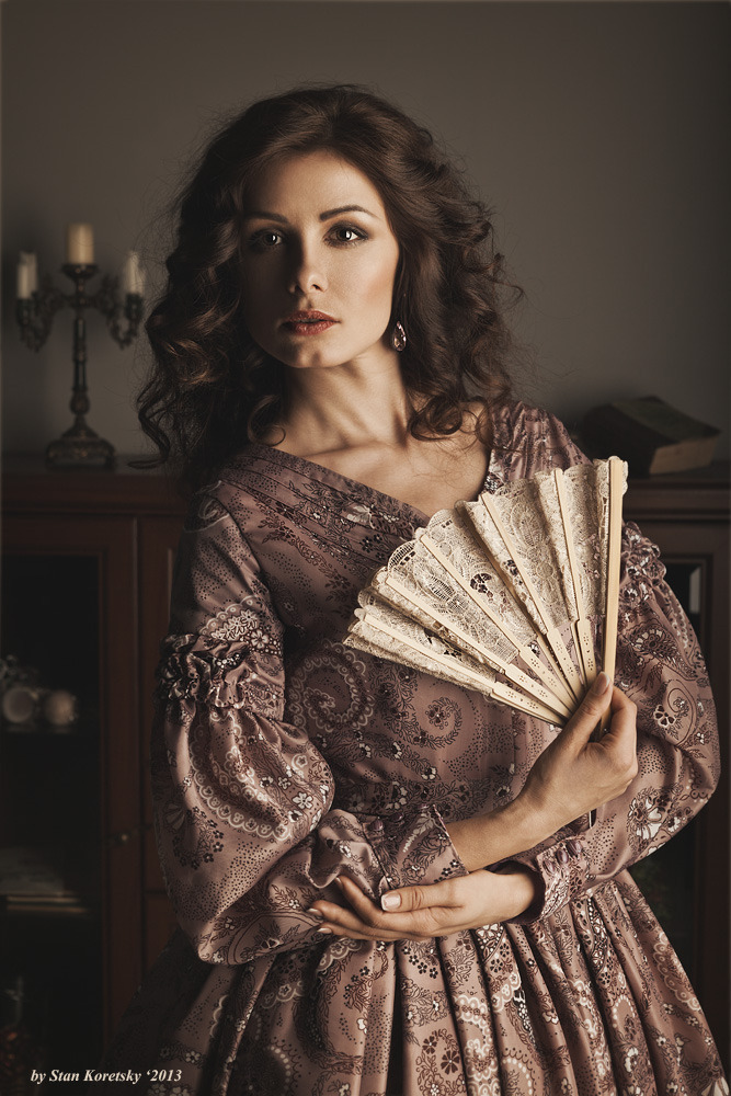 Beautiful woman with a fan | model, woman, beautiful, brunette, hair-do , make-up, dress, fan, old-fashioned, candlestick