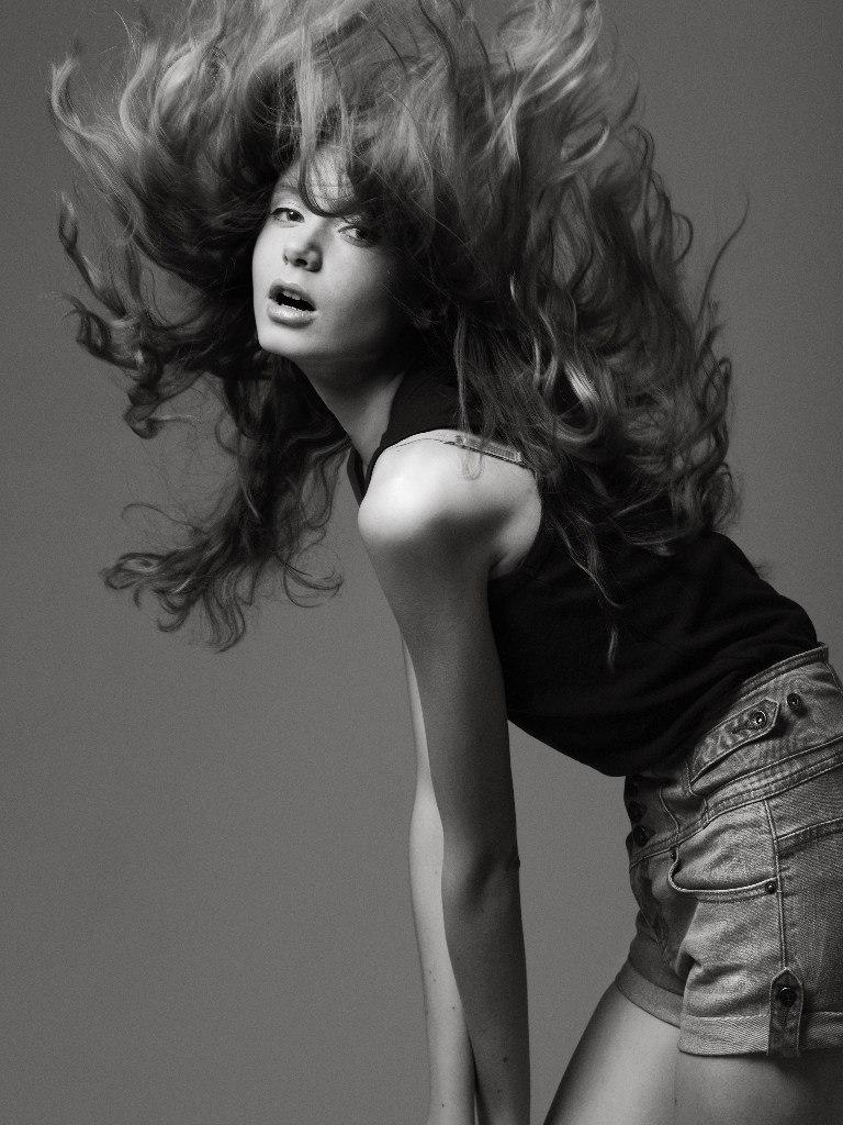 Black & white photo of a skittish girl | glamour   , model, girl, long hair, black & white , slim, top , short shorts, lips , skittish