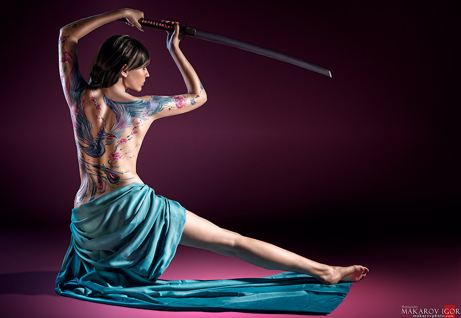Tattoed girl with sword | tatoo , girl, sword