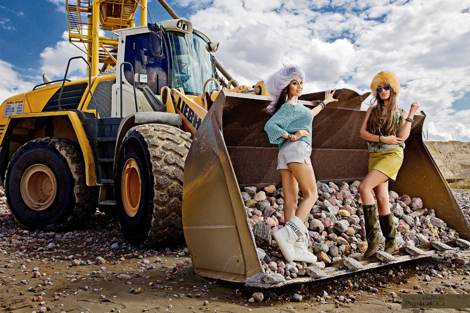 two fashion models in excavator bucket | girls, excavator, sky, clouds, stones, fur hats, model, fashion, accessories, slim