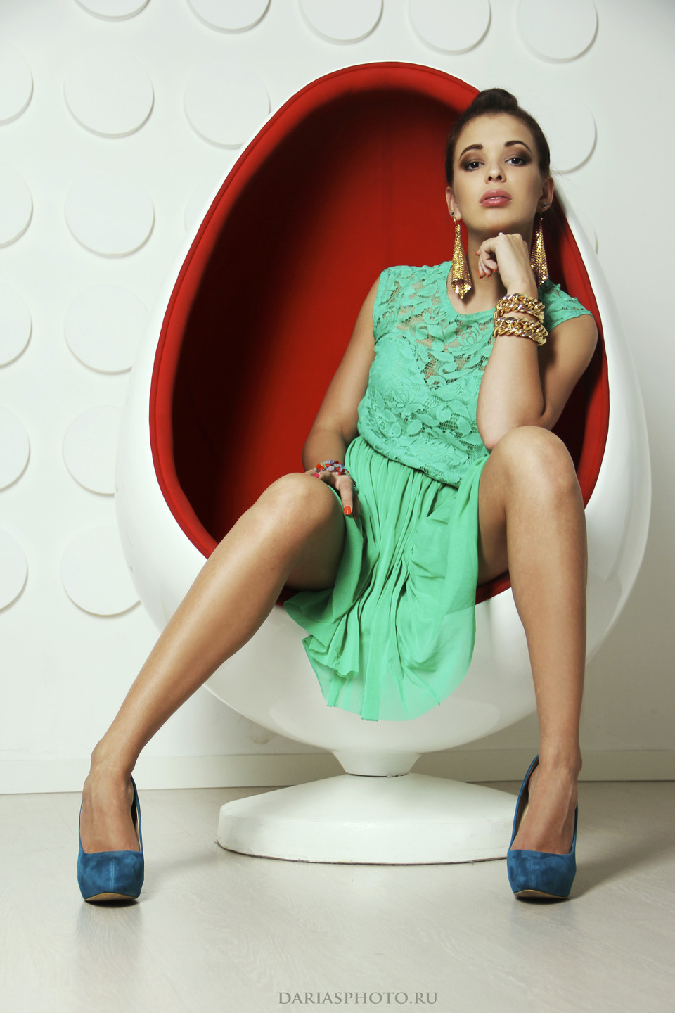 Sexy girl sitting in an egglike armchair | armchair, sexy girl, photo shoot