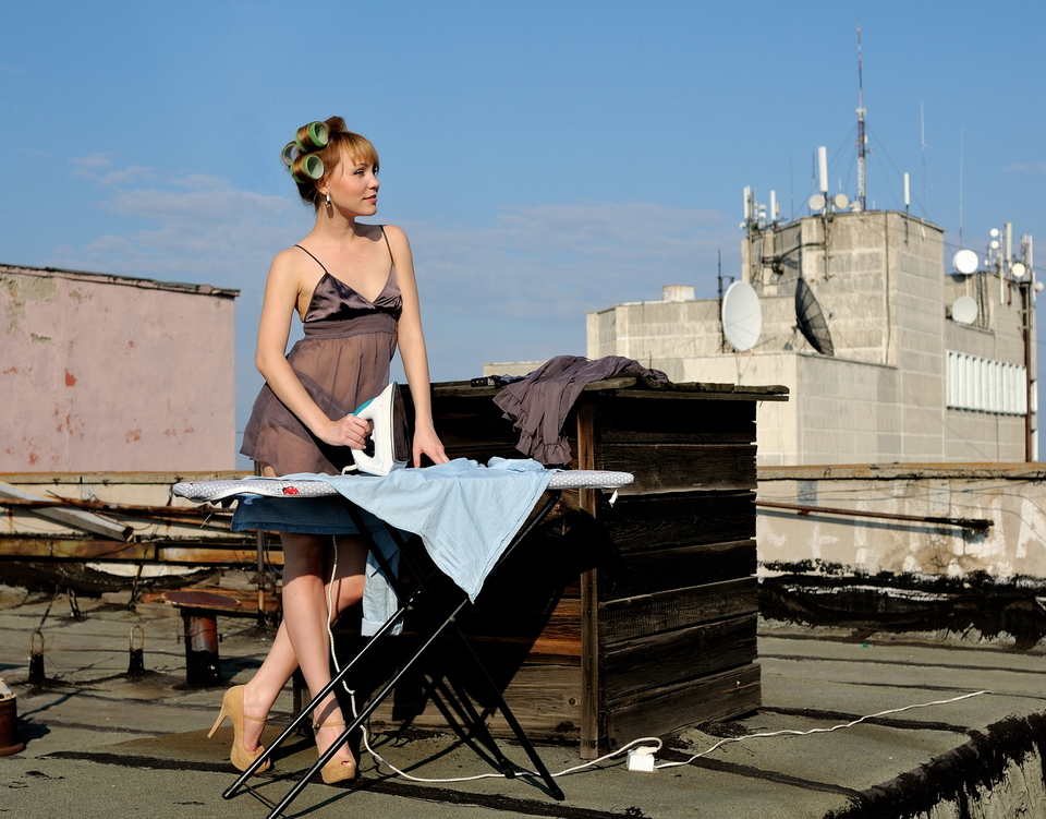 Housewife irons on the roof | housewife, on the roof, irons