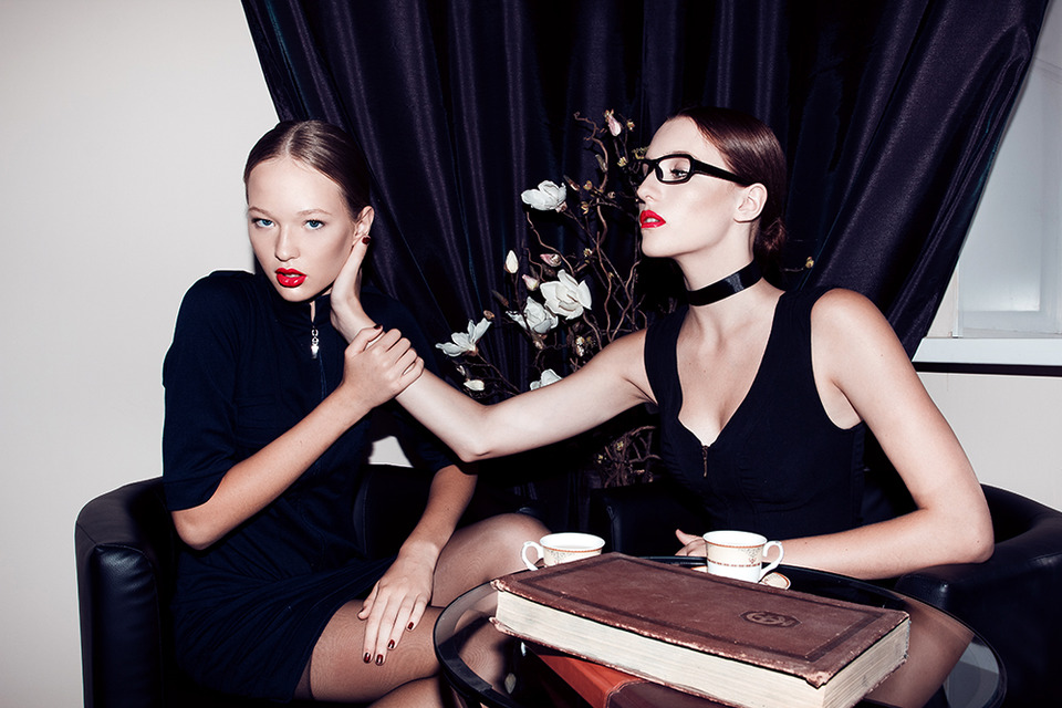 Two sexy girls in black dresses | glamour, models, room, sexy girls, red lipstick, glasses, cup, table, black dress, book