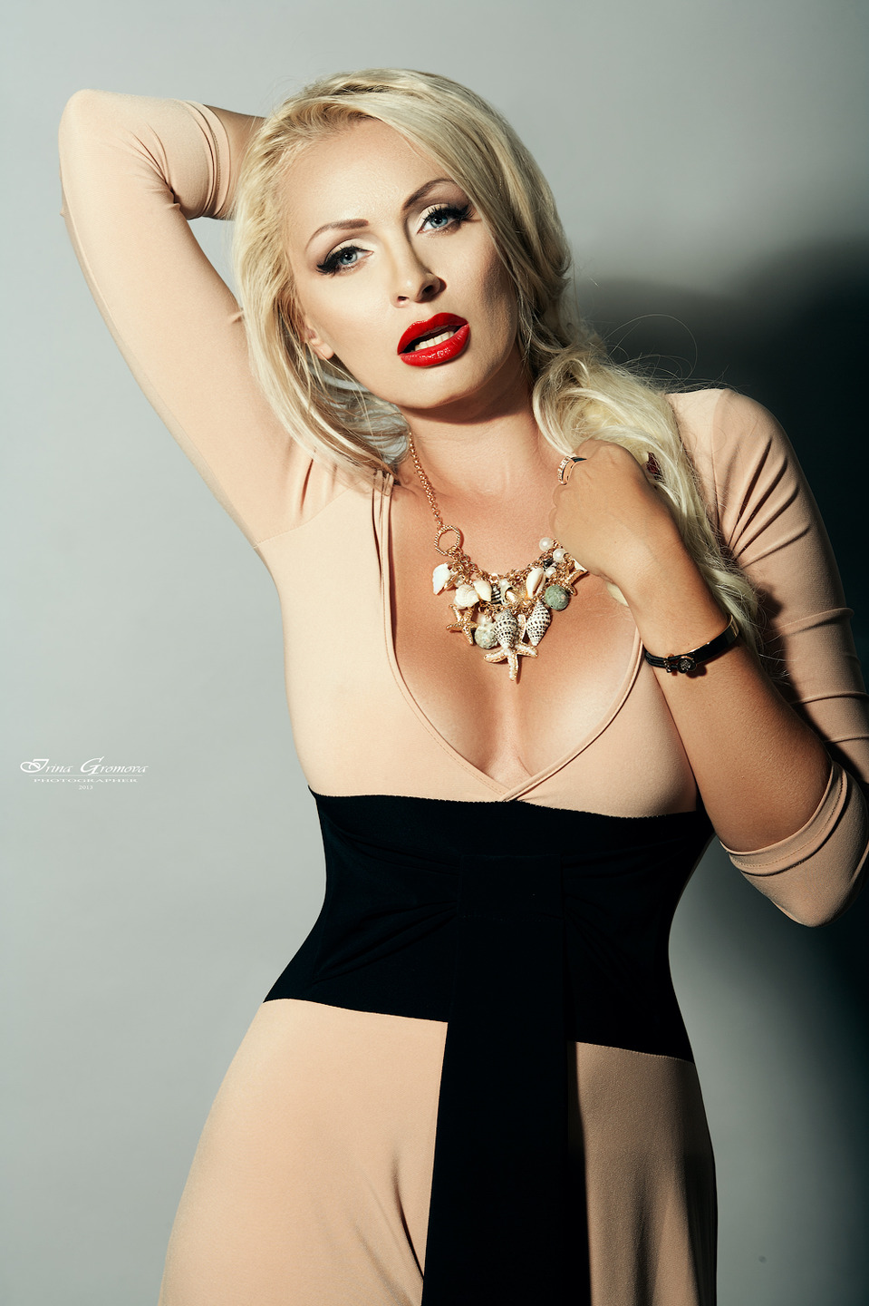 A beautiful woman with nice necklace | necklace, blond, red lipstick