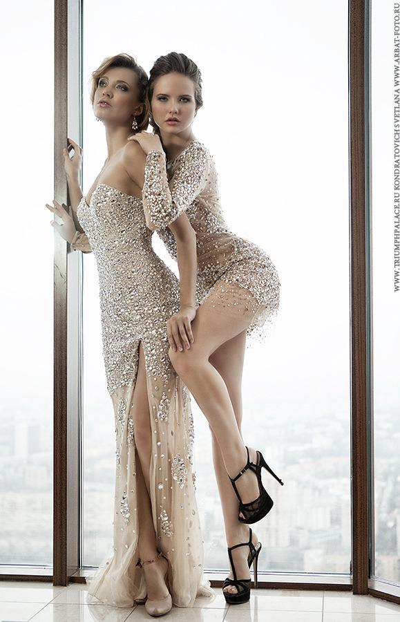 Two models standing by the window | two models, window, skyscraper, sky